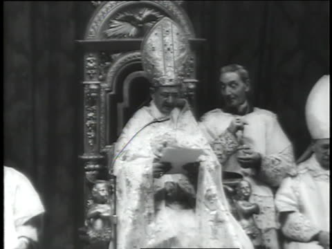 vidéos et rushes de a line of prelates pay homage to pope paul vi, seated on a throne, as his trip to the holy land is announced. - prêtre