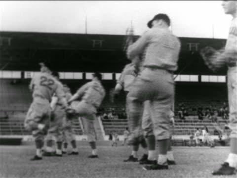 vídeos y material grabado en eventos de stock de b/w 1938 line of professional baseball players throwing balls in practice - uniforme de béisbol