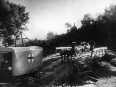 line of red cross wagons crossing bridge / russo-japanese war / documentary - red cross stock videos & royalty-free footage