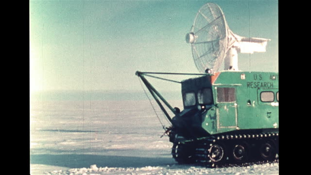ws line of red flags standing in snow landscape special truck passing receiver dish male scientist climbing into tracking station finger on 'tape... - antarctica scientist stock videos & royalty-free footage