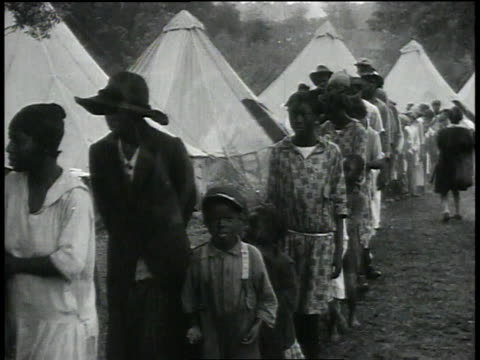 line of refugee children walking through camp / baton rouge louisiana united states - baton rouge stock-videos und b-roll-filmmaterial