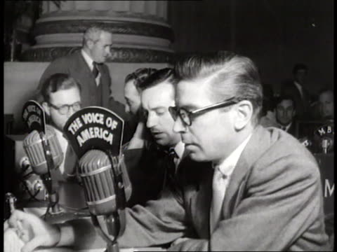 a line of reporters talk into the voice of america microphones - radio broadcasting stock videos & royalty-free footage