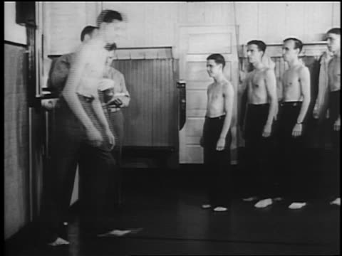 b/w 1941 line of shirtless military recruits being measured / documentary - shirtless stock videos & royalty-free footage