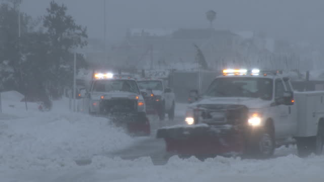 a line of snow plows clear deep snow off of ocean avenue in belmar nj during the historic blizzard of 2016 - ocean avenue stock videos & royalty-free footage