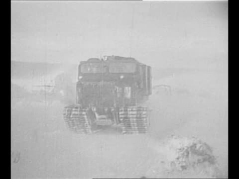 vídeos de stock, filmes e b-roll de line of snow tractors in arctic circle / snow blows in mountain area of arctic circle / montage snow tractors drive / montage man works with... - pile driver
