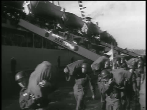 b/w 1954 line of soldiers carrying bags walking off ship at port / returning from korean war - 1954 stock videos & royalty-free footage