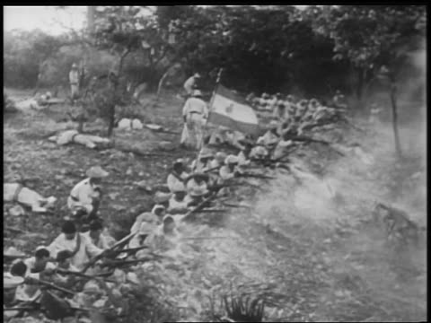 B/W 1898 REENACTMENT line of Spanish soldiers in trench firing in battle in Spanish-American war