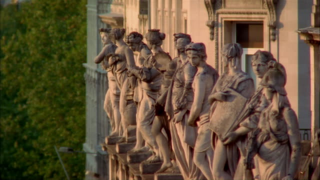 Line of statues of Roman goddesses standing on entablature of Grand Theatre de Bordeaux / Bordeaux, France