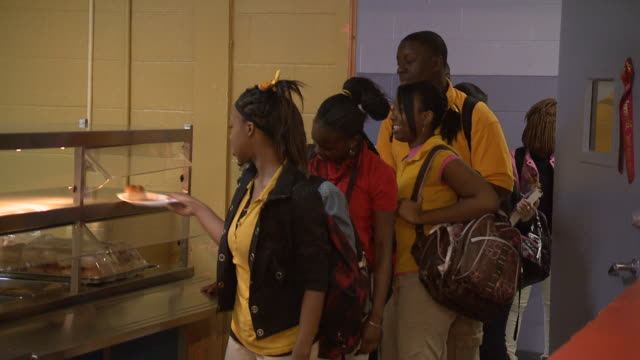 ws a line of students receiving lunch in the cafeteria / marks mississippi united states - female high school student stock videos & royalty-free footage