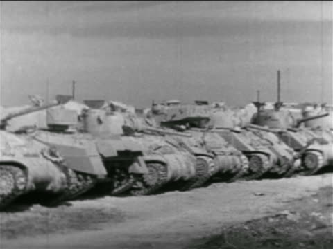 line of tanks parked outdoors / suez crisis / newsreel - 1956 stock-videos und b-roll-filmmaterial