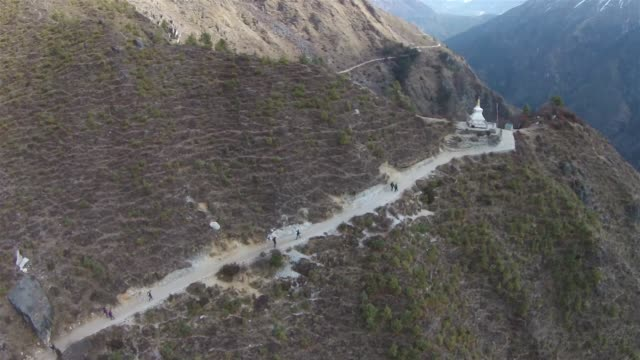 a line of trekkers walk along a trail near the town of namche bazaar in the solukhumbu region of nepal february 8 2015 the solukhumbu region is home... - khumbu stock videos and b-roll footage