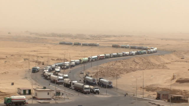 ws zo pov line of trucks in desert waiting for ferry, suez isthmus, egypt - suez canal stock videos & royalty-free footage