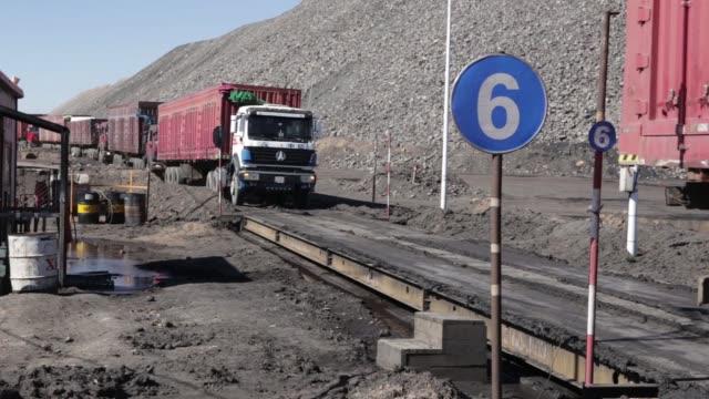 A line of trucks wait to be loaded with coal from the Tavan Tolgoi coal deposit developed by Erdenes Tavan Tolgoi JSC a unit of Erdenes Mongol LLC in...