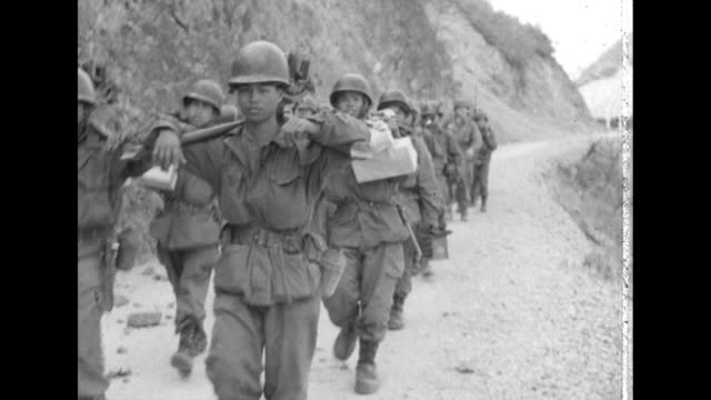 line of u.s. marines descend a mountain trail in south korea. - 1951 stock videos & royalty-free footage