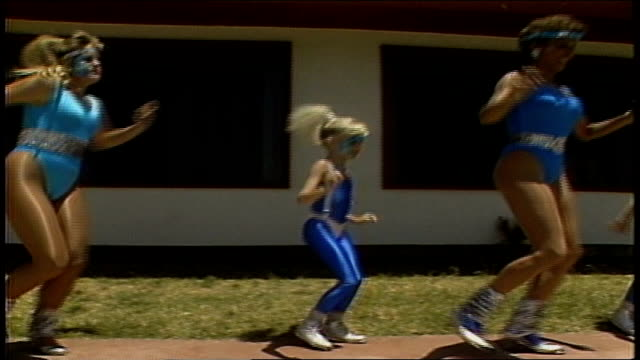 line of woman and girls in blue outfits tap dancing on ledge - 1987 stock videos & royalty-free footage