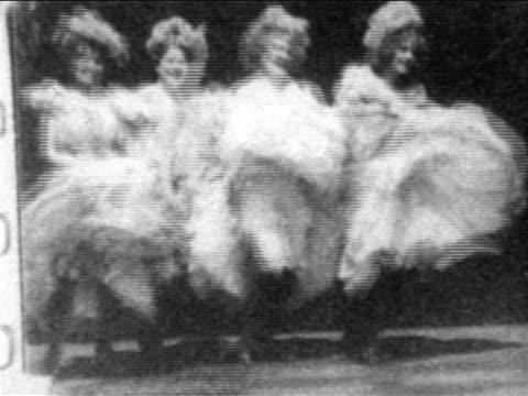 b/w 1902 line of women dancing can-can at moulin rouge / france - b roll stock videos & royalty-free footage