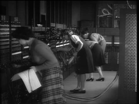 b/w 1946 line of women man plugging wires into eniac computer - mainframe stock videos & royalty-free footage