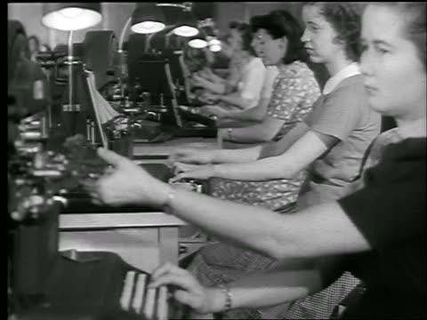 B/W 1944 line of women working at machines issuing War Bonds / Chicago / World War II / newsreel