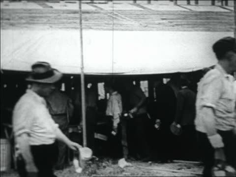 b/w 1932 line of wwi veterans getting food under tent / bonus march in washington dc - 1932 stock videos & royalty-free footage