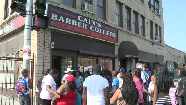 wgn line outside barber shop for free haircuts on august 24 2013 in chicago illinois - barber shop stock videos and b-roll footage