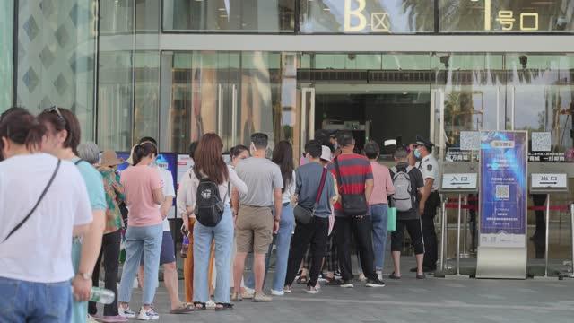 line up at duty free shops,sanya,china. - selling stock videos & royalty-free footage