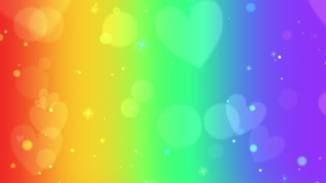 Linear rainbow looping hearts bokeh background