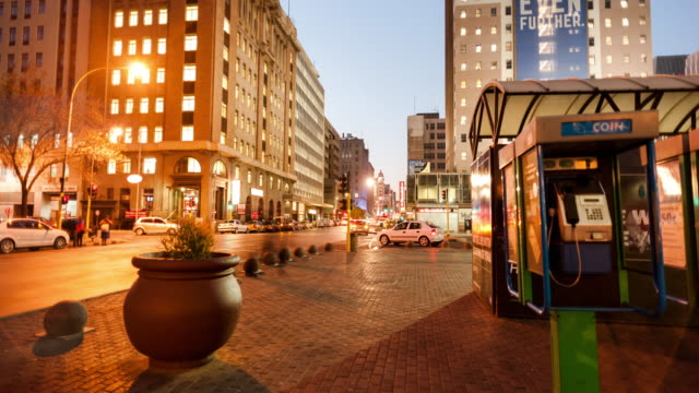 linear timelapse at night of ghandi square in the city centre of johannesburg, south africa during peak traffic time with hustle and bustle as people leave from work - south africa stock videos & royalty-free footage