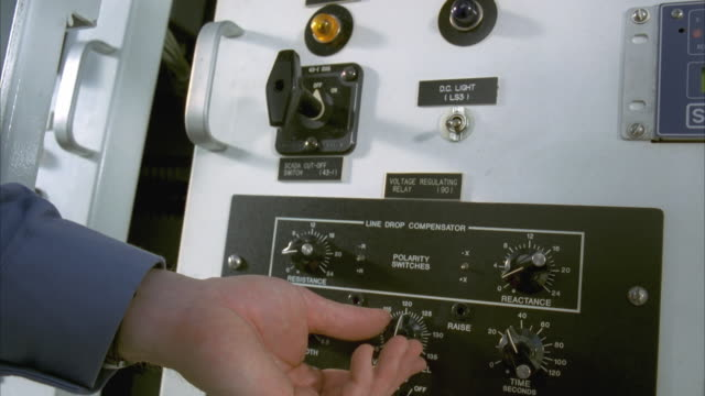 slo mo cu tu lineman adjusting knobs on control panel at substation / cedar park, texas, usa - cedar park texas stock videos & royalty-free footage