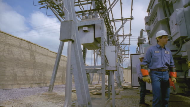 cs slo mo ws lineman carrying tools past other linemen working at substation / cedar park, texas, usa - cedar park texas stock videos & royalty-free footage