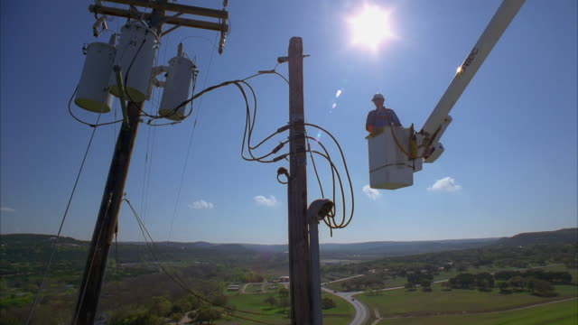 cs slo mo ws la pan lineman in bucket truck approaching power lines / canyon lake, texas, usa - maintenance engineer stock videos & royalty-free footage