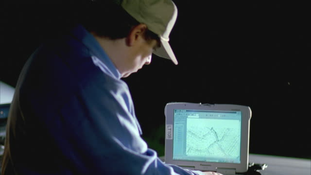 slo mo ms lineman looking at laptop displaying mapping system / cedar park, texas, usa - cedar park texas stock videos & royalty-free footage