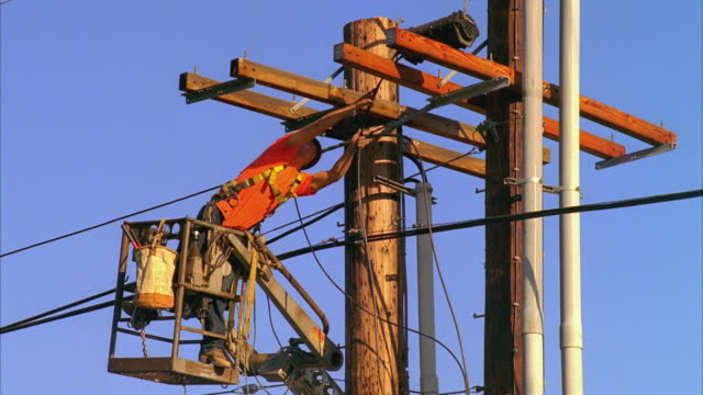 ws lineman on top of electricity pole removing and discarding apparatus, montecito, california, usa - maintenance engineer stock videos & royalty-free footage