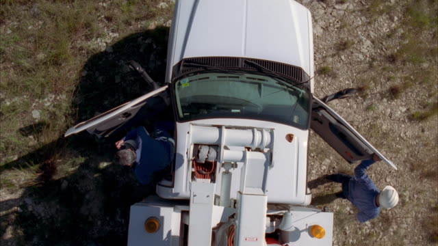 cs slo mo ws linemen exiting truck / johnson city, texas, usa - maintenance engineer stock videos & royalty-free footage