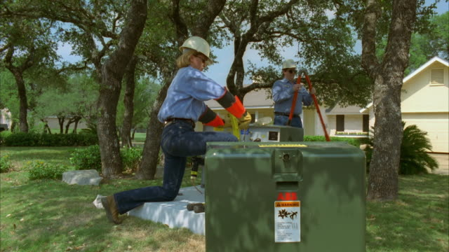 slo mo ws linemen, male and female, repairing ground transformer / johnson city, texas, usa - see other clips from this shoot 1842 stock videos & royalty-free footage