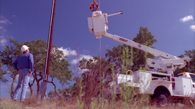 cs slo mo ws linemen using bucket truck / johnson city, texas, usa - see other clips from this shoot 1842 stock videos & royalty-free footage