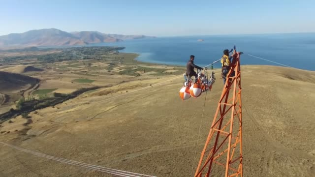 linemen work at the construction of new highvoltage transmission line between siirt and van provinces in eastern turkey on october 08 2017 lineman... - 整備員点の映像素材/bロール