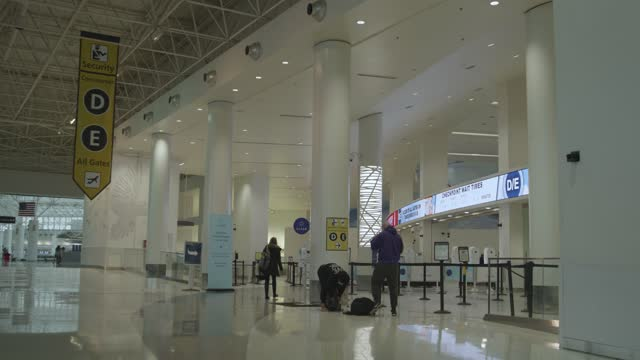 lines at security are empty for the holidays during the coronavirus pandemic at baltimore washington international airport on december 18, 2020 in... - three people stock videos & royalty-free footage