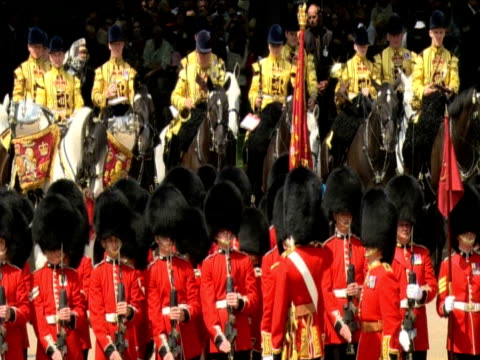 lines of grenadier guards march on parade during trooping the colour ceremony london 13 june 2009 - 近衛兵点の映像素材/bロール