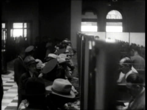 lines of people waiting outside bank and at window inside bank getting silver coins / mexico - four in a row stock videos & royalty-free footage