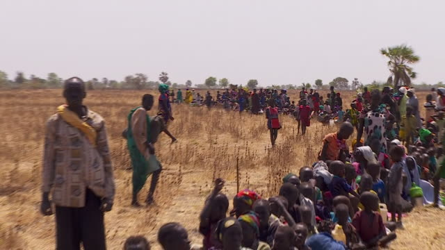 Lines of people waiting to receive food aid in South Sudan