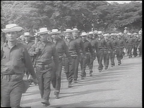 b/w 1962 lines of soldiers in uniforms hats marching past camera / cuban missile crisis - cuban missile crisis stock videos & royalty-free footage