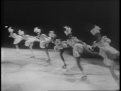 lines of women iceskating around a group of women waving fabric at easter themed ice skating show for 8th annual carnival of the skating club of new... - anno 1941 video stock e b–roll