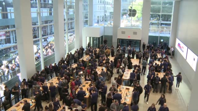 lines wrap around an apple store in new york early morning as the apple's flagship iphone x hit stores around the world - flagship store stock videos and b-roll footage
