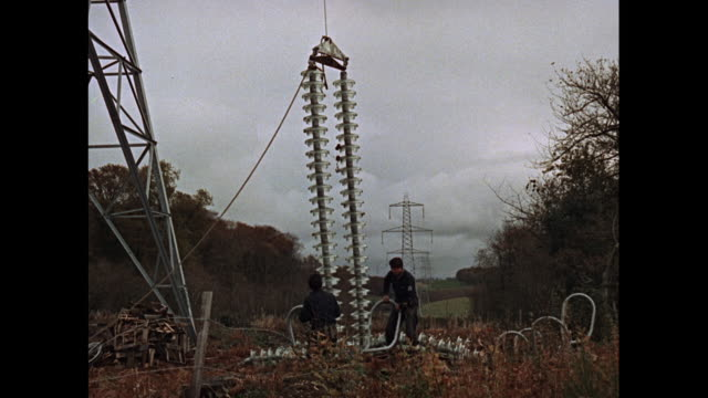 MONTAGE Linesmen working on power lines in United Kingdom