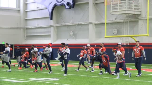 lingering winter snow storm coverd the denver broncos practice field so the team used the indoor practice facility to go through drills on the friday... - playoffs stock videos & royalty-free footage
