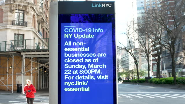 linknyc box with a coronavirus disease informational digital advertisement on the upper west side of broadway manhattan, new york city. - road sign stock videos & royalty-free footage