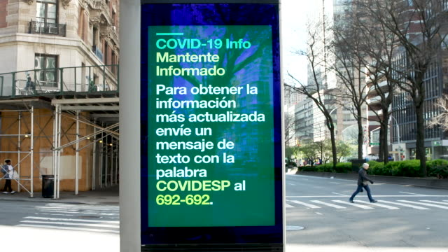 vidéos et rushes de linknyc box with a coronavirus disease informational digital advertisement on the upper west side of broadway manhattan, new york city. - panneau commercial