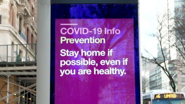 linknyc box with a coronavirus disease informational digital advertisement on the upper west side of broadway manhattan new york city - broadway manhattan video stock e b–roll