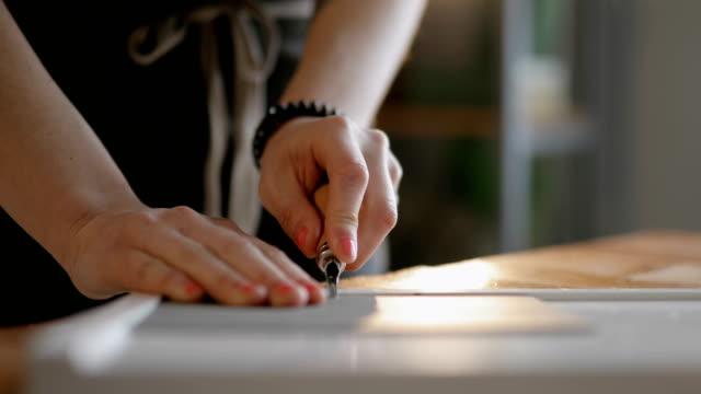 Linocut artist at work