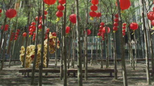 lion dance amongst trees - マレーシア点の映像素材/bロール
